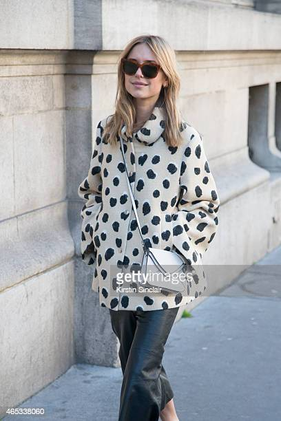 Fashion blogger Pernille Teisbaek wears Acne Studio coat Envie trousers Boy bag and Celine sunglasses on day 3 of Paris Collections Women on March 05...