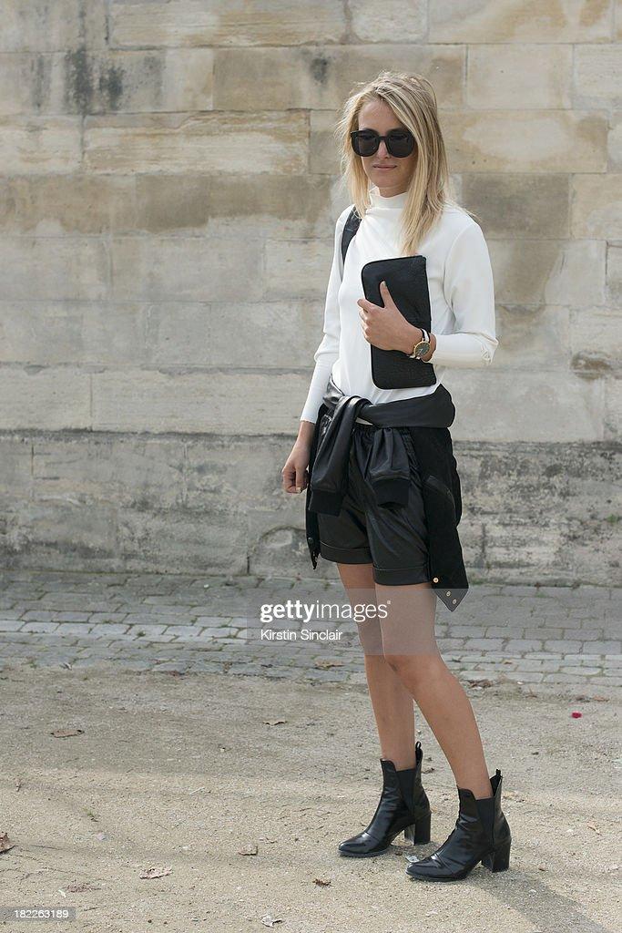 Fashion Blogger Rebecca Laurey wears Karen Walker sunglasses, Zara top and boots, Nordstrom shorts and a Nomadic bag on day 5 of Paris Fashion Week Spring/Summer 2014, Paris September 28, 2013 in Paris, France.
