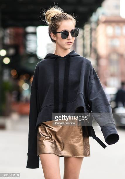 Fashion Blogger Rosa Crespo is seen in Noho wearing a Nude jumper Matel gold skirt and Quay sunglasses on May 11 2017 in New York City
