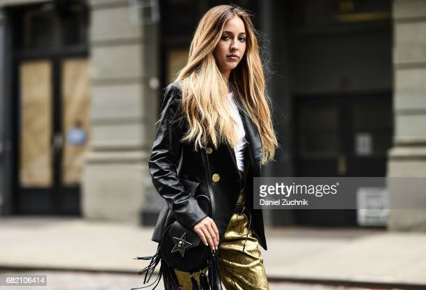 Fashion Blogger Rosa Crespo is seen in Noho wearing an Iorane World tshirt Nude black jacket Nude gold pants and Salar Milano bag on May 11 2017 in...