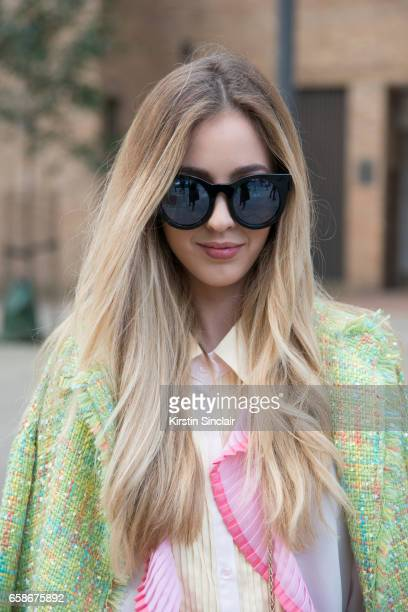 Fashion blogger Rosa Crespo wears a Storets shirt and jacket and Quay sunglasses on day 3 of London Womens Fashion Week Autumn/Winter 2017 on...