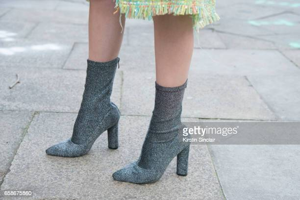 Fashion blogger Rosa Crespo wears Top Shop boots on day 3 of London Womens Fashion Week Autumn/Winter 2017 on February 19 2017 in London England