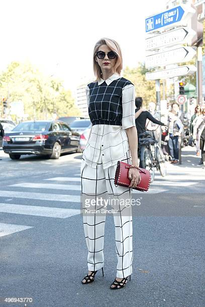 Fashion Blogger Samantha Angelo wears a Club Monaco shirt Line and Dots top Chloe trousers Manolo shoes Valentino bag and Miu Miu sunglasses on day 6...
