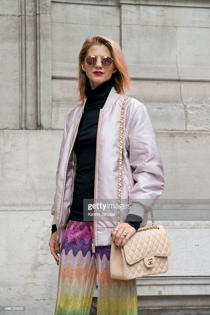 Fashion Blogger Samantha Angelo wears Missoni trousers Acne jacket Maison Margiela sweater Chanel bag and Rayban sunglasses on day 7 during Paris...