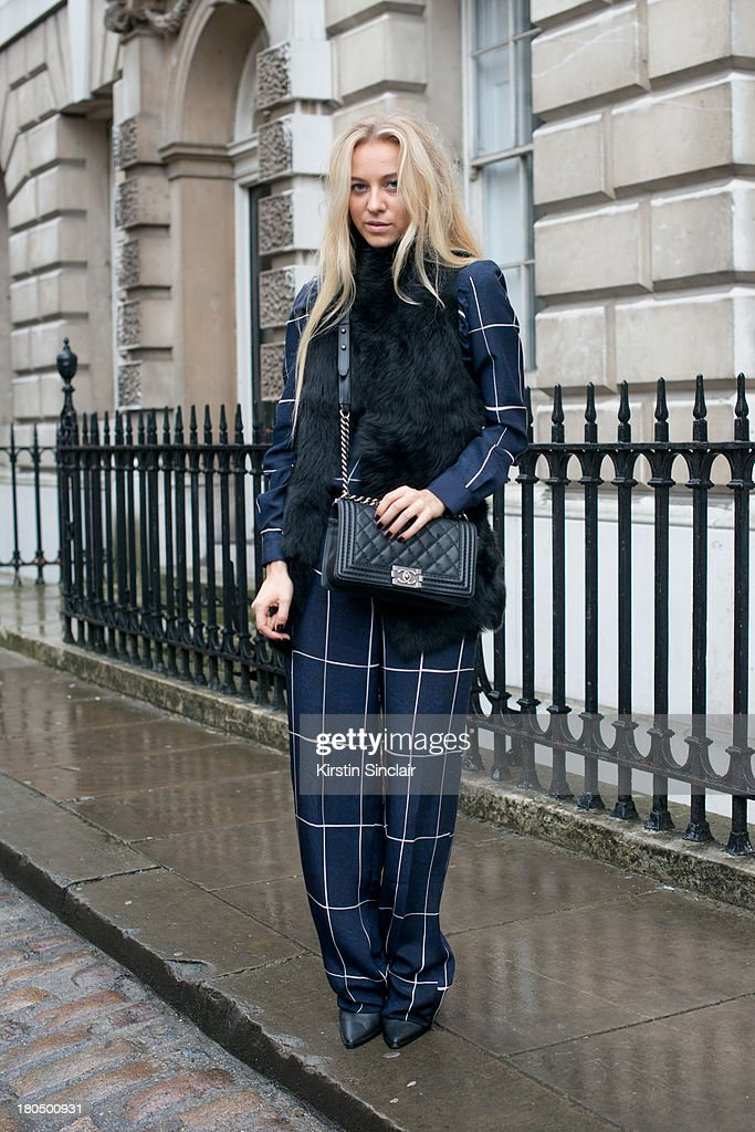 Fashion Blogger Sandra Hagelstam wears a Whistles suit and Gillet, Chanel bag and Tibi boots on day 1 of London Fashion Week Spring/Summer 2013, at Somerset House on September 13, 2013 in London, England.