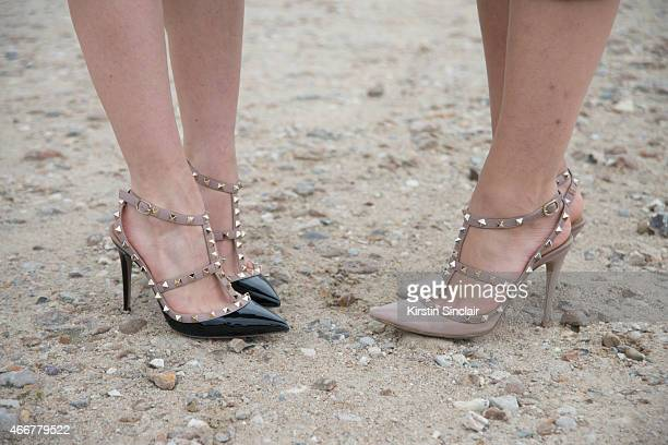 Fashion blogger Sandra Hagelstam wears Valentino shoes with Tamara Killinic who wears Valentino shoes on day 8 of Paris Collections Women on March 10...