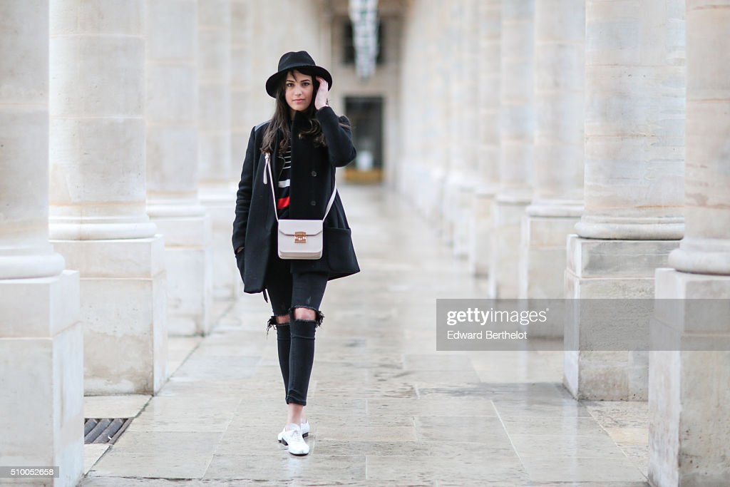 Fashion blogger Sarah Benziane (Les Colonnes de Sarah) wearing a Zara knit, a Maje coat, Repetto shoes, Primark jeans and an Andie Blue bag on February 13, 2016 in Paris, France.