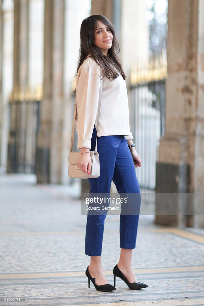 Fashion blogger Sarah Benziane (Les Colonnes de Sarah) wearing an And Other Stories top, Charles and Keith shoes, an Andie Blue bag and a Zara necklace during a street style session on February 13, 2016 in Paris, France.