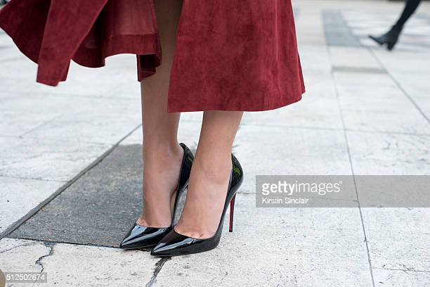 Fashion blogger Sarah Ellen wears a Rachel Zoe skirt and Christian Louboutin shoes on day 3 during London Fashion Week Autumn/Winter 2016/17 on...