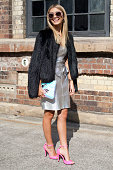 Fashion Blogger Sarah Ellen wears Miu Miu sunglasses Bec and Bridge dress and jacket and a vintage bag at MercedesBenz Fashion Week Australia 2015 at...