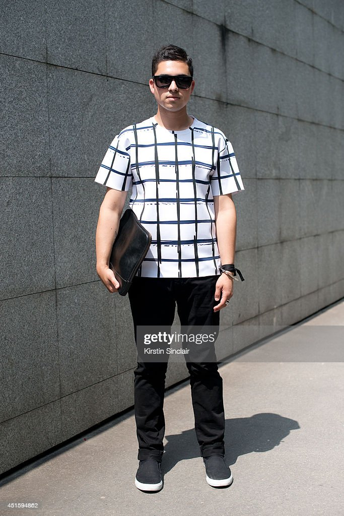 Fashion blogger Scott Shapiro wearing Kenzo T shirt, Sandro jeans, Vans trainers, vintage sunglasses and a Zara clutch bag on day 2 of Paris Collections: Men on June 26, 2014 in Paris, France.