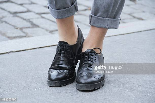Fashion blogger seen on the streets of Manhattan wearing grey suit pants and black leather Zara brogues shoes on November 22 2015 in New York City