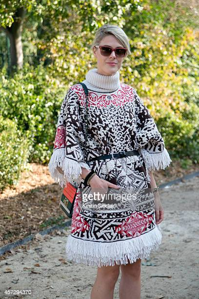Fashion Blogger Sofie Valkiers is wearing an Emilio Pucci poncho Elie Saab bag and Furla sunglasses on day 9 of Paris Collections Women on October 01...