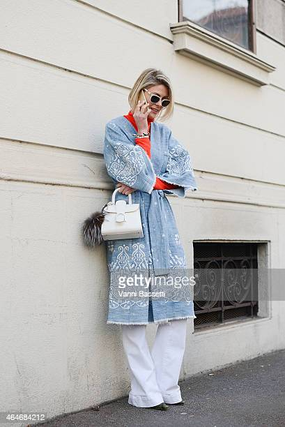 Fashion Blogger Sofie Valkiers poses wearing a Sea New York kimono during Milan Fashion Week on February 27 2015 in Milan Italy