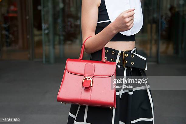 Fashion blogger Sofie Valkiers wears a Cos top F Edigio skirt and a Delvaux bag day 4 of Paris Haute Couture Fashion Week Autumn/Winter 2014 on July...
