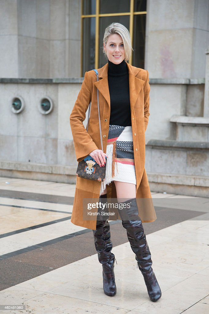 Fashion Blogger Sofie Valkiers wears a Louis Vuitton handbag Magda Butrym coat and skirt and Aperlai boots on day 4 of Paris Haute Couture Fashion...