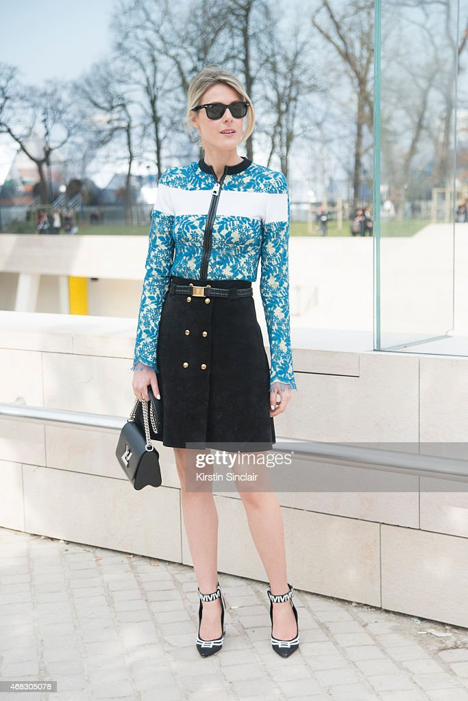 Fashion blogger Sofie Valkiers wears all Louis Vuitton with Ray Ban sunglasses on day 9 of Paris Collections Women on March 11 2015 in Paris France