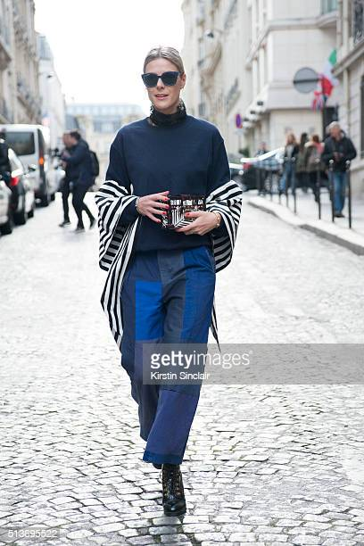 Fashion blogger Sofie Valkiers wears Dior sunglasses Louis Vuitton bag and Win Bruynooghe top and trousers on day 3 during Paris Fashion Week...