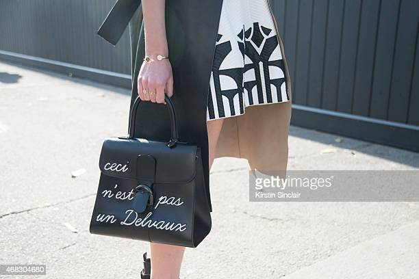 Fashion blogger Sofie Valkiers wears Silvian Heach dress Gerard Darel coat and Delvaux bag on day 9 of Paris Collections Women on March 11 2015 in...