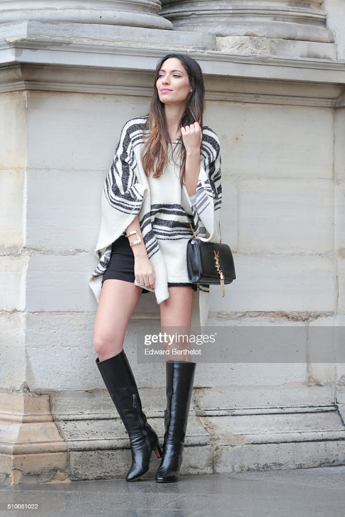 Fashion blogger Sofya Benzakour (La Couleur du Moment) wearing a Zara top, a Zara short, a YSL bag and Mi-Mai boots during a street style session on February 13, 2016 in Paris, France.