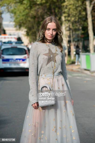 Fashion blogger Sonya Esman wears Dior sweater skirt and bag day 1 of Paris Womens Fashion Week Spring/Summer 2018 on September 26 2017 in Paris...