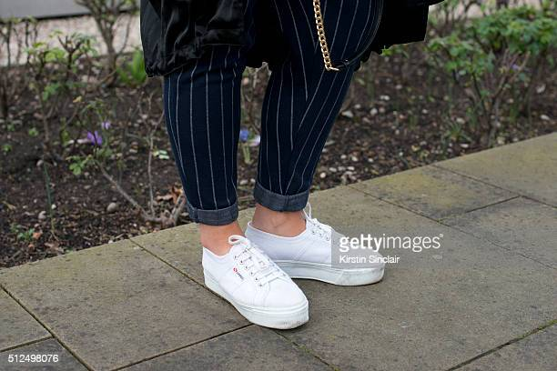 Fashion blogger Sophie Allen wears a Native Youth trousers and Superga shoes on day 3 during London Fashion Week Autumn/Winter 2016/17 on February 21...