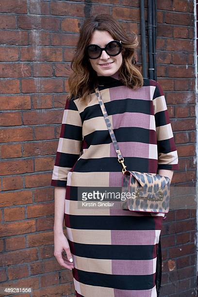 Fashion blogger Sophie Green wears Sophie Hulme bag Prada sunglasses and ASOS White dress on day 2 during London Fashion Week Spring/Summer 2016/17...