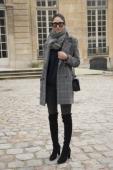 Fashion Blogger Soraya Bakhtia wears a Chanel bag Vanessa Bruno coat Stuart Weitzman boots All Saints jeans Italia Independent sunglasses and Topshop...
