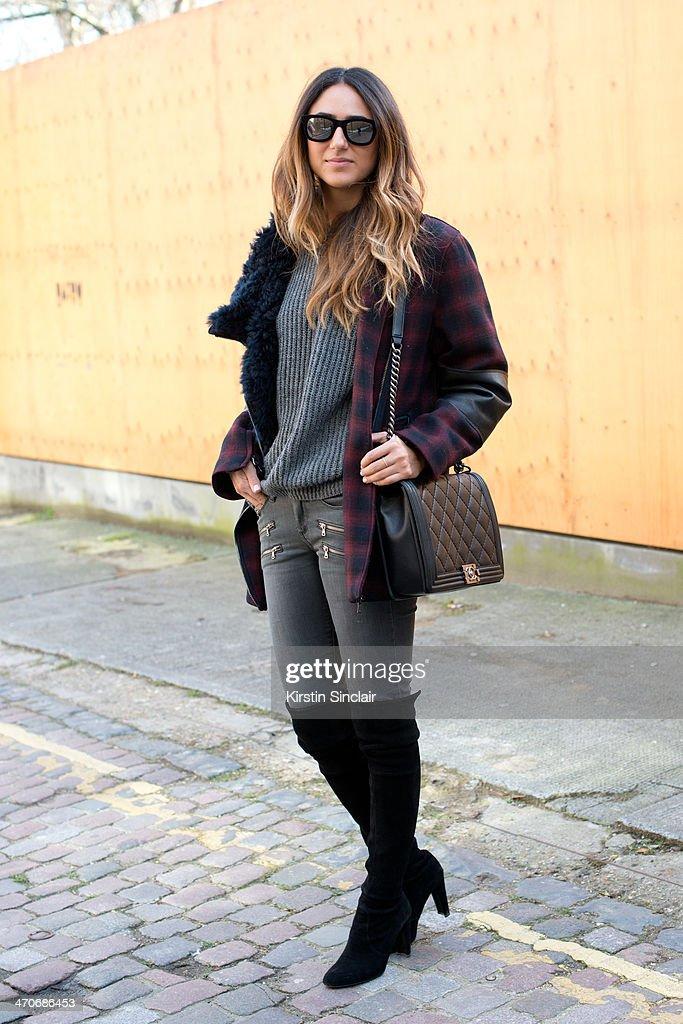Fashion Blogger Soraya Bakhtiar wears a Phillip Lim jacket Beige jeans Stuart Weitzman boots Zara sweater Chanel bag and Italia Independent...
