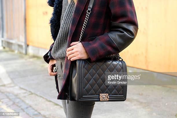 Fashion Blogger Soraya Bakhtiar wears a Phillip Lim jacket Beige jeans Chanel bag Zara sweater on day 3 of London Collections Women on February 16...