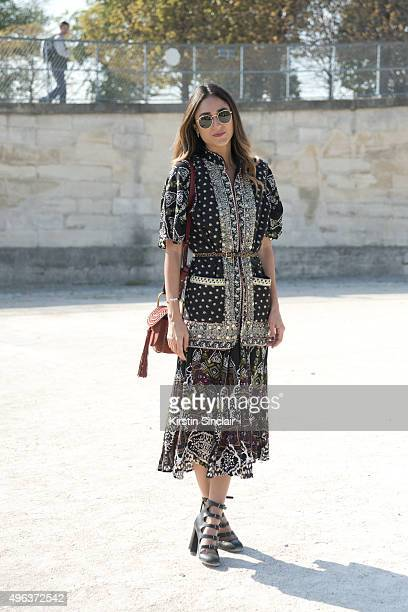 Fashion Blogger Soraya Bakhtiar wears a Zara jacket Free People dress Marc Jacobs shoes Chloe bag and Rayban sunglasses on day 5 during Paris Fashion...