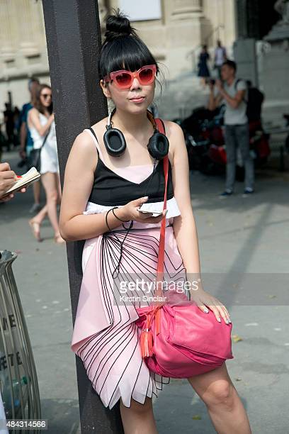 Fashion blogger Susie Lau wears a Christopher Kane dress Jonathan Saunders sunglasses and a Loewe bag on day 3 of Paris Fashion Week Haute Couture...