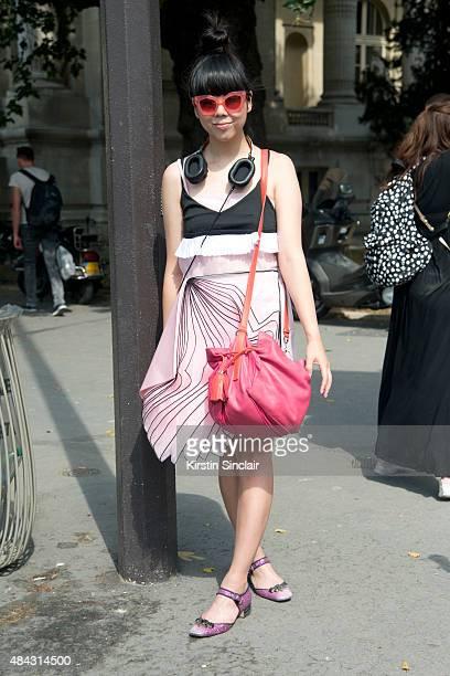 Fashion blogger Susie Lau wears a Christopher Kane dress Miu Miu shoes Jonathan Saunders sunglasses and a Loewe bag on day 3 of Paris Fashion Week...