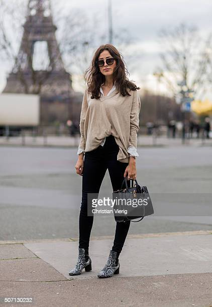 Fashion blogger Sylvia Haghjoo wearing Sandro blouse and sweater Celine sunglasses Isabel Marant shoes bag Louis Vuitton during the Paris Fashion...
