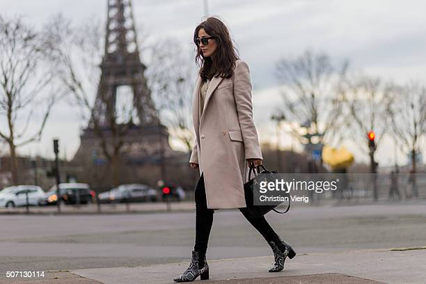 Fashion blogger Sylvia Haghjoo wearing Stella McCartney coat Sandro blouse and sweater Celine sunglasses Isabel Marant shoes bag Louis Vuitton during...