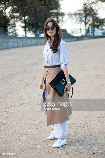 Fashion Blogger Silvia Haghjoo wears a Chloe bag Superga trainers Christian Dior sunglasses A R Nouveau shirt dress and skirt on day 8 during Paris...