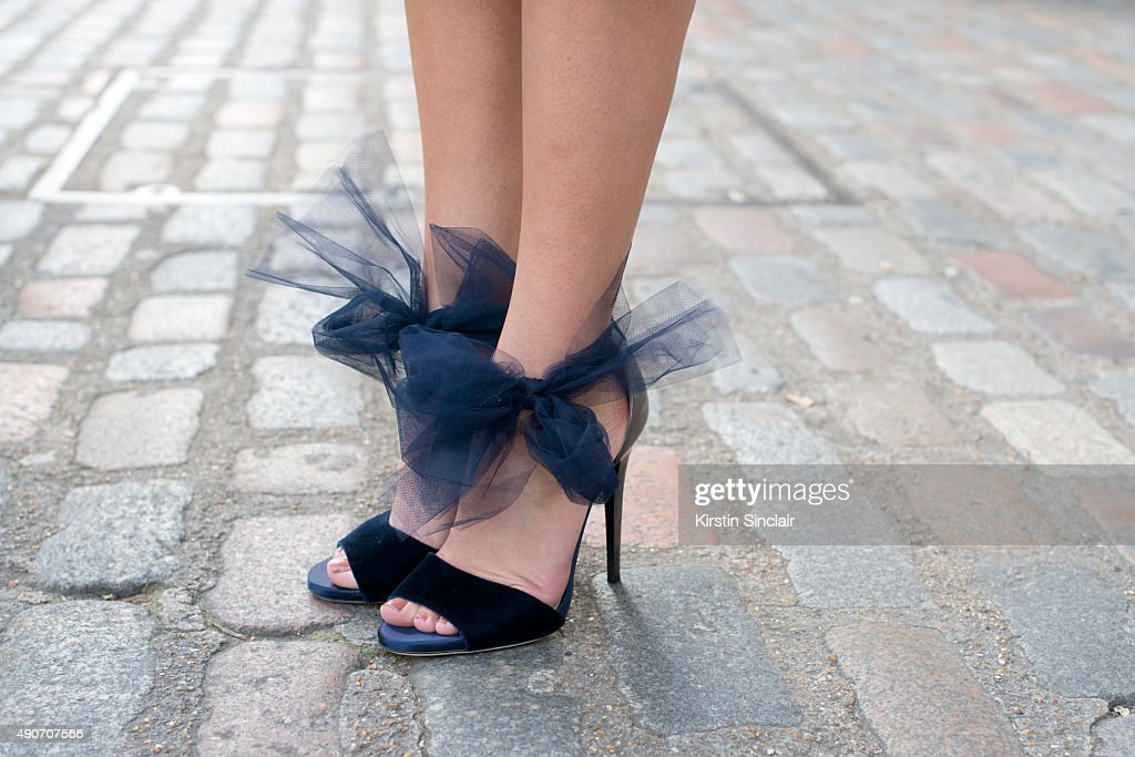 Fashion Blogger Sylvia Haghjoo wears Jimmy Choo shoes on day 3 during London Fashion Week Spring/Summer 2016/17 on September 20 2015 in London England