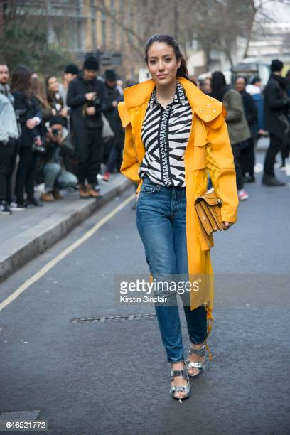 Fashion blogger Tamara Kalinic wearing Girlfriend jeans Bvlgari bag and a Versus jacket top and shoes on day 2 of London Womens Fashion Week...