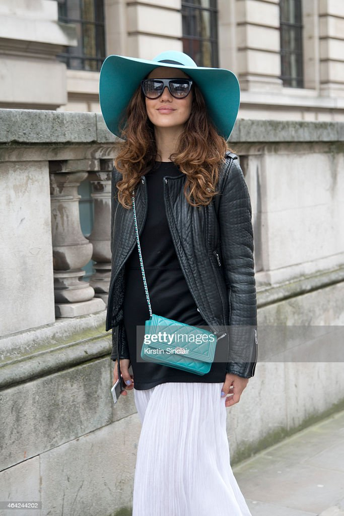 Fashion Blogger Tamara Kalinic wears a Chanel bag Celine sunglasses Maison Michel hat Sandro dress and a Maje jacket on day 3 of London Collections...