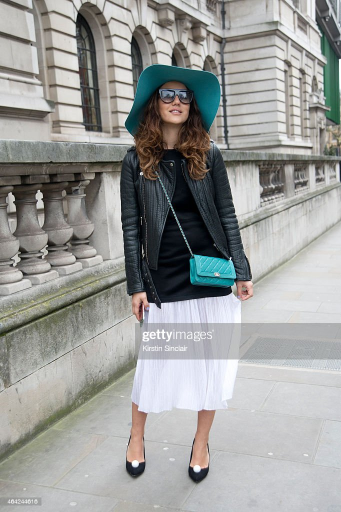 Fashion Blogger Tamara Kalinic wears a Chanel bag, Celine sunglasses, Maison Michel hat, Kurt Geiger shoes, Sandro dress and a Maje jacket on day 3 of London Collections: Women on February 22, 2015 in London, England.