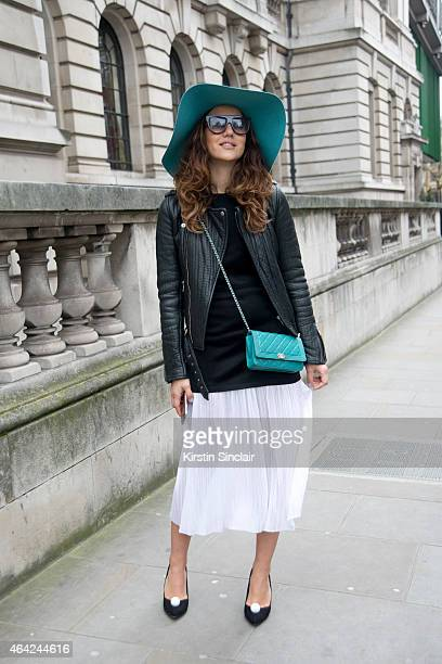 Fashion Blogger Tamara Kalinic wears a Chanel bag Celine sunglasses Maison Michel hat Kurt Geiger shoes Sandro dress and a Maje jacket on day 3 of...