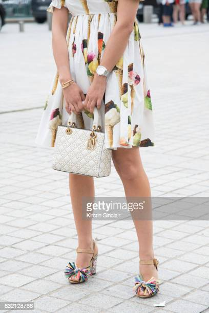 Fashion blogger Tamara Kalinic wears a Dolce Gabanna dress shoes and a Dior bag day 2 of Paris Haute Couture Fashion Week Autumn/Winter 2017 on July...