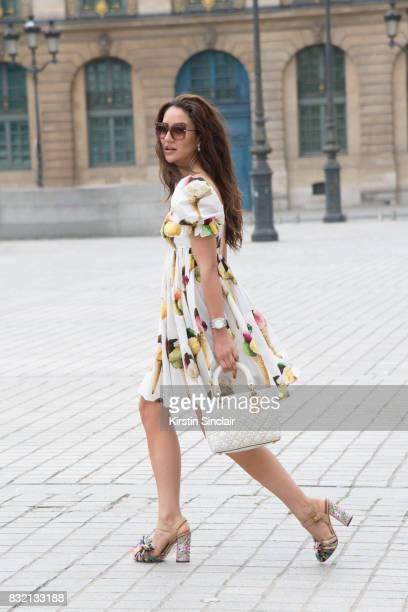 Fashion blogger Tamara Kalinic wears a Dolce Gabanna dress shoes and sunglasses with a Dior bag day 2 of Paris Haute Couture Fashion Week...