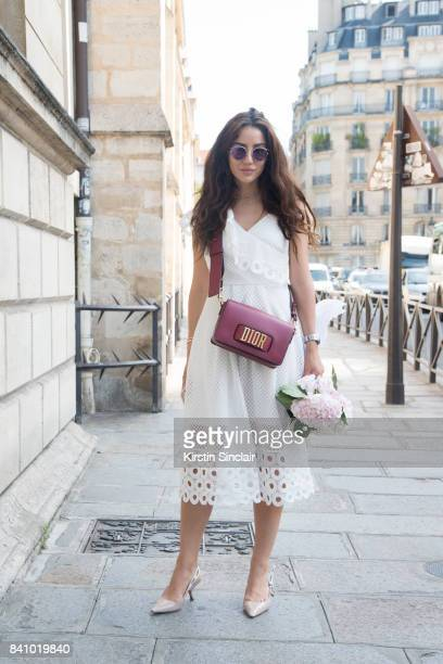 Fashion blogger Tamara Kalinic wears a Next Directory dress Dior bag necklace and shoes day 3 of Paris Haute Couture Fashion Week Autumn/Winter 2017...