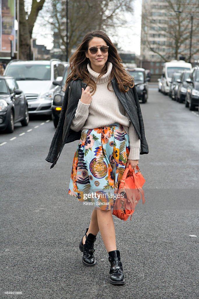 Fashion blogger Tamara Kalinic wears Balenciaga boots Dior sunglasses Proenza Schoeler bag Maje jacket MSGM skirt and Topshop sweater on February 24...