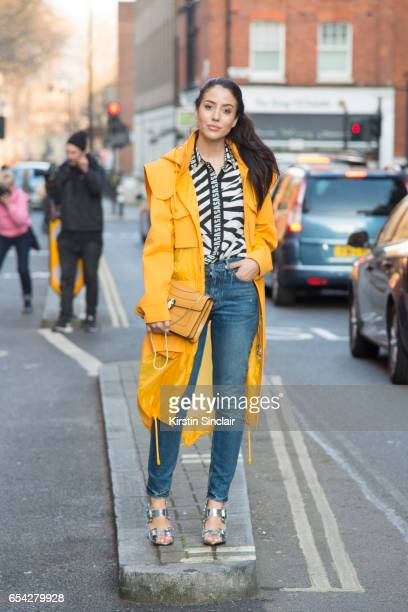 Fashion blogger Tamara Kalinic wears Girlfriend jeans Mulberry bag and Versus shoes top and jacket on day 2 of London Womens Fashion Week...