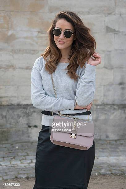 Fashion blogger Tamara Kallinic wears an Isabel Marant Supertrash skirt Valentino bag and Dior sunglasses on day 5 of Paris Collections Women on...