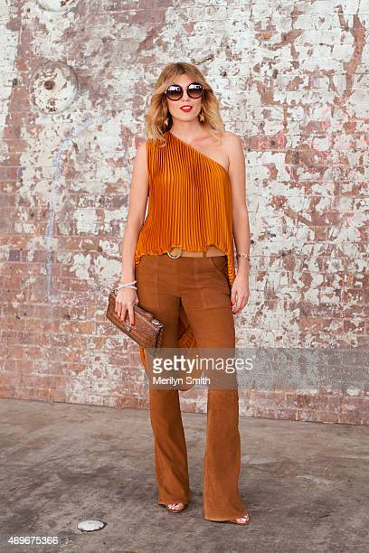 Fashion Blogger Tanja Gacic wears a Tome dress J brand trousers and Someday Somewhere sunglasses at MercedesBenz Fashion Week Australia 2015 at...