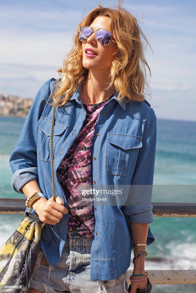 Fashion Blogger Tanja Gacic wears One Teaspoon shorts Proenza Schouler tshirt Bec and Bridge shirt Jerome Dreyfus bag and Rayban sunglasses at...
