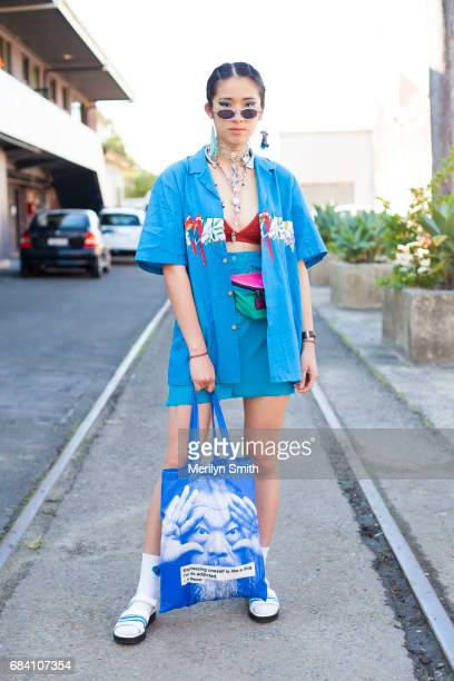 Fashion Blogger Tara Chandra wearing a vintage top and skirt Charles and Keith shoes and a Ai Wei Wei shopper bag during MercedesBenz Fashion Week...